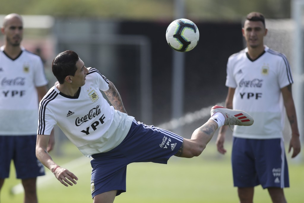 Argentina's Angel Di Maria kicks the ball during a training session for the Copa America in Porto Alegre, Brazil, Monday, June 24, 2019. (AP Photo/Edi...