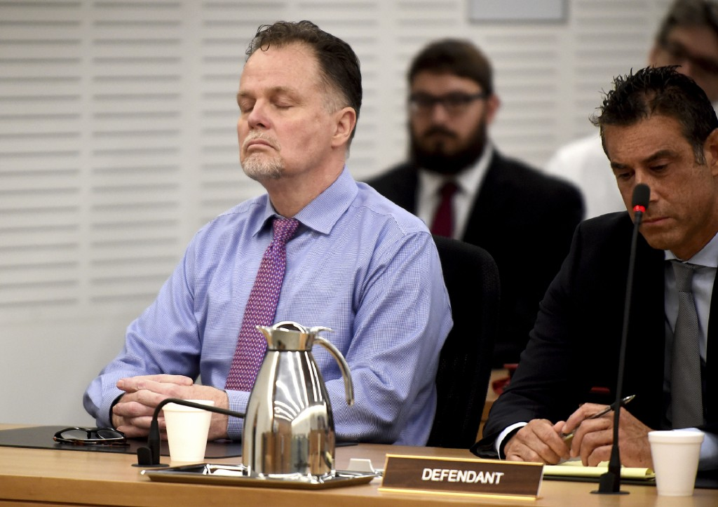 """FILE - In this June 10, 2019 file photo, Charles """"Chase"""" Merritt, left, reacts after being found guilty of four counts of first-degree murder of the M..."""