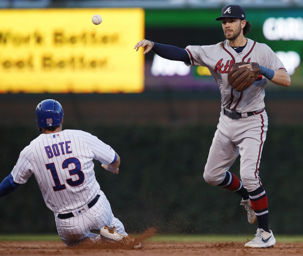 Chicago Cubs' David Bote, left, is out at second base as Atlanta Braves' Dansby Swanson throws to first base during the second inning of a baseball ga...