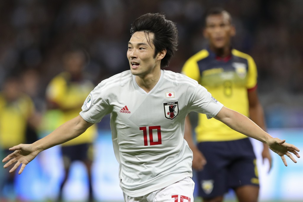Japan's Shoya Nakajima celebrates after scoring his side's first goal against Ecuador during a Copa America Group C soccer match at the Mineirao stadi...