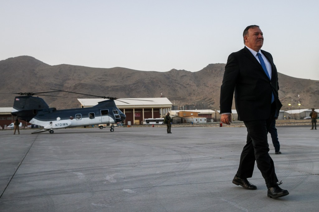 Secretary of State Mike Pompeo walks from a helicopter to return to his plane, Tuesday, June 25, 2019, at the end of an unannounced visit to Kabul, Af...