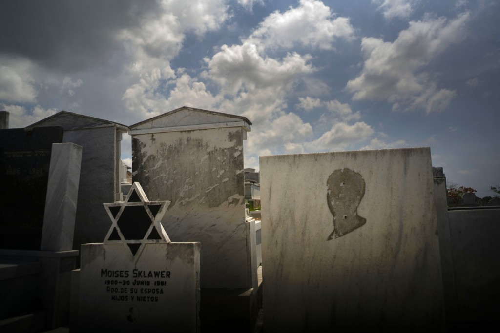 Tombs decorated with the Star of David, and one lacking the image of a person, stand in the Jewish cemetery in Guanabacoa, eastern Havana, Cuba, June ...