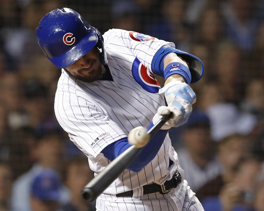 Chicago Cubs' Kris Bryant hits an RBI-single against the Atlanta Braves during the fifth inning of a baseball game Monday, June 24, 2019, in Chicago. ...