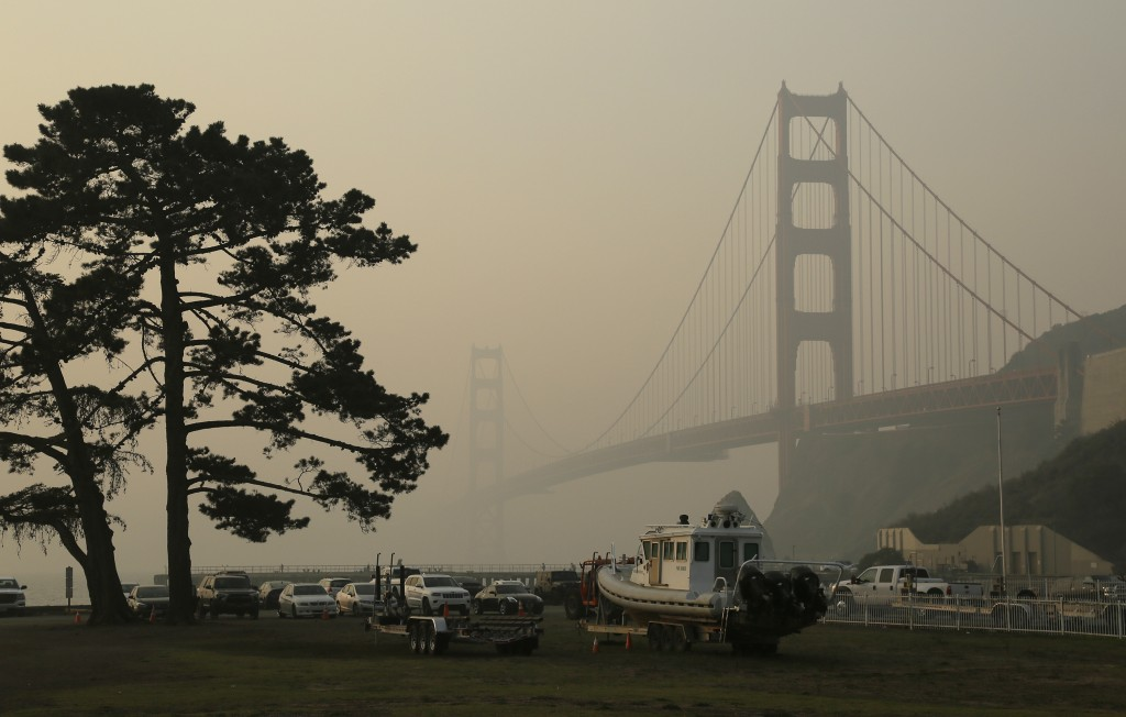 FILE - In this Nov. 16, 2018, file photo, the Golden Gate Bridge is obscured by smoke and haze from wildfires in this view from Fort Baker near Sausal