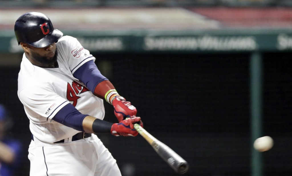 Cleveland Indians' Carlos Santana hits a double in the fourth inning in a baseball game against the Kansas City Royals, Monday, June 24, 2019, in Clev...