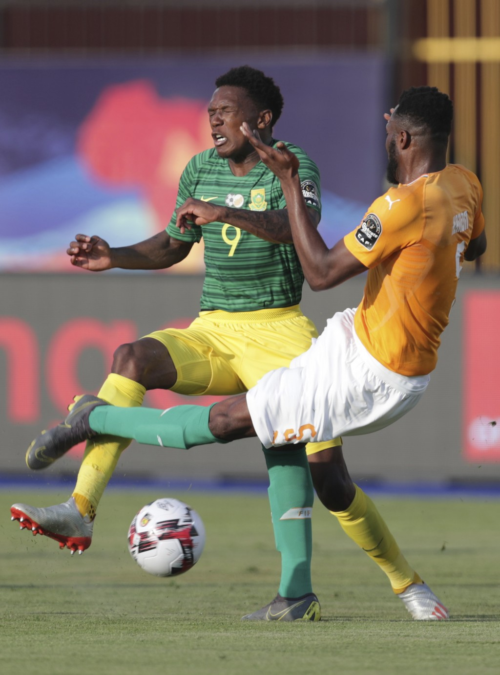 South Africa's Lebo Mothiba, left, fights for the ball with Ivory Coast's Serge Wilfried Kanon during the African Cup of Nations group D soccer match ...