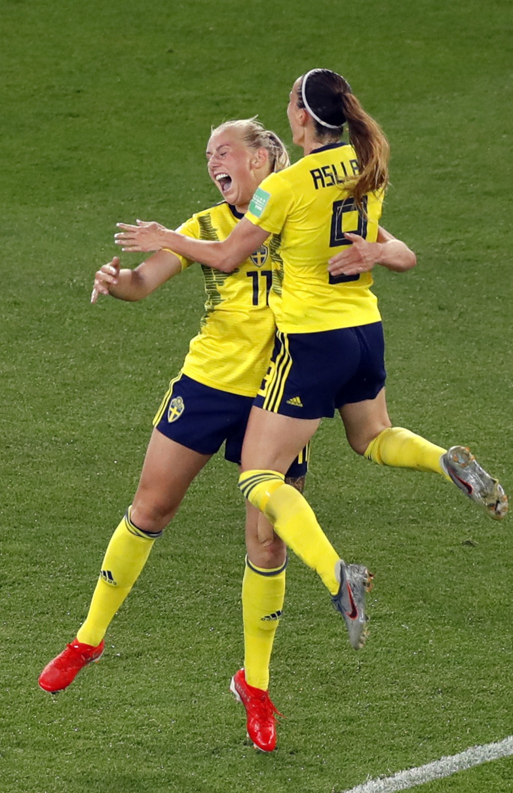Sweden's Stina Blackstenius celebrates with Kosovare Asllani, right, after scoring the opening goal during the Women's World Cup round of 16 soccer ma...
