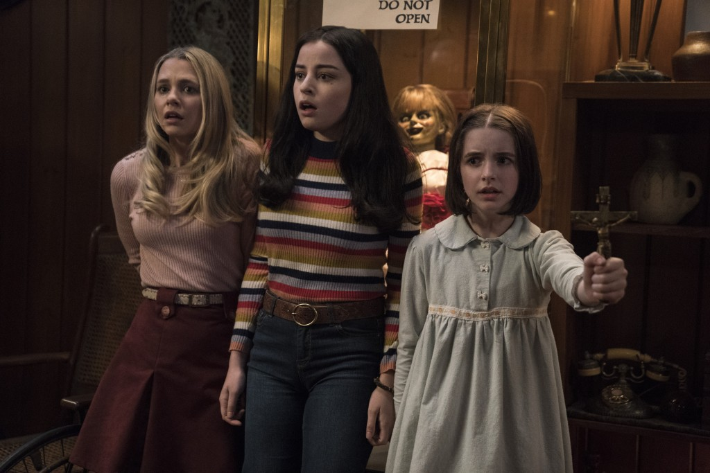 """This image released by Warner Bros. Pictures shows Madison Iseman, from left, Katie Sarife and McKenna Grace in a scene from the horror film, """"Annabel"""