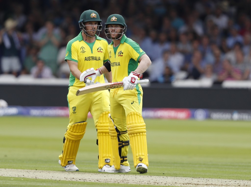 Australia's David Warner, right celebrates with teammate Australia's captain Aaron Finch after getting 50 runs not out during their Cricket World Cup ...