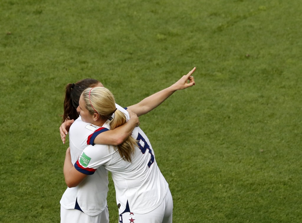 United States players celebrate at the end of the Women's World Cup round of 16 soccer match between Spain and United States at Stade Auguste-Delaune ...