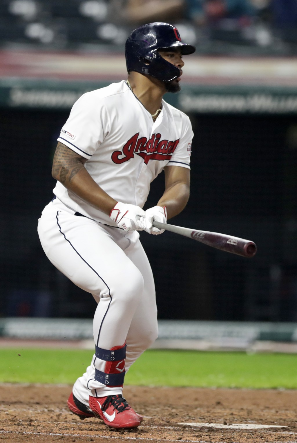 Cleveland Indians' Bobby Bradley watches his ball after hitting a one-run double in the sixth inning in a baseball game against the Kansas City Royals...