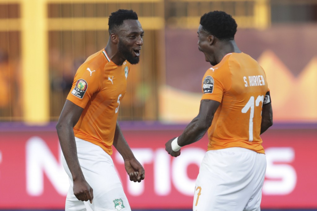 Ivory Coast's Serge Wilfried Kanon, left, and Ivory Coast's Serge Aurier celebrate end of the African Cup of Nations group D soccer match between Ivor...