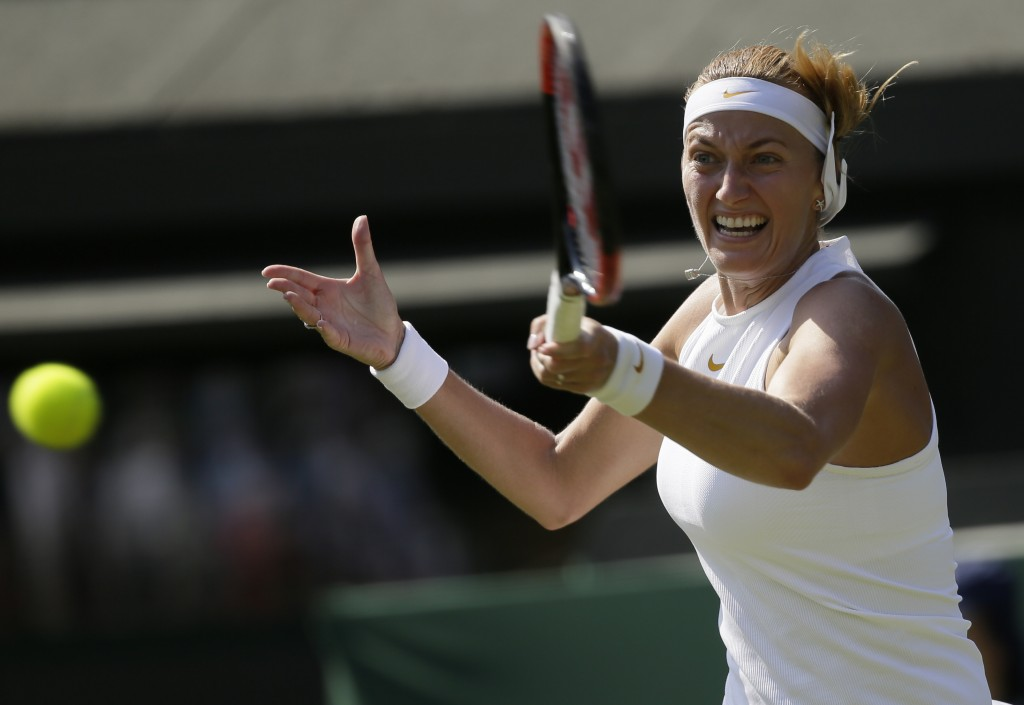 FILE - In this July 3, 2018, file photo, Petra Kvitova of the Czech Republic returns a ball to Aliaksandra Sasnovich of Belarus during their women's s...