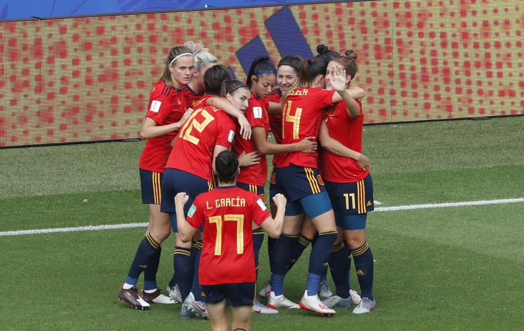 Spain's Jennifer Hermoso celebrates with teammates after scoring her side's first goal during the Women's World Cup round of 16 soccer match between S...