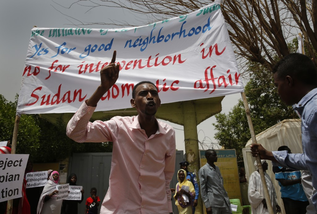 A Sudanese supporter of the military council, shouts slogans during a sit-in against Ethiopian mediation, outside the Ethiopian embassy, in Khartoum, ...