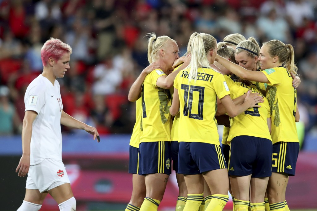 Team Sweden celebrates after scoring the opening goal during the Women's World Cup round of 16 soccer match between Canada and Sweden at Parc des Prin...