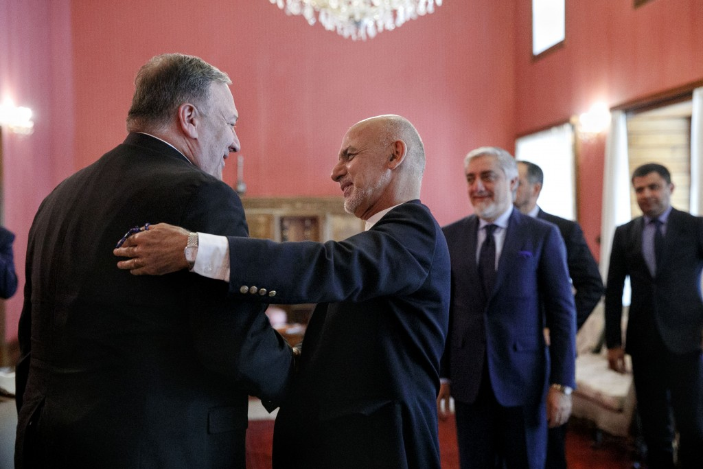 Secretary of State Mike Pompeo, left, is greeted by Afghan President Ashraf Ghani, at the Presidential Palace in Kabul, Afghanistan, Tuesday, June 25,...