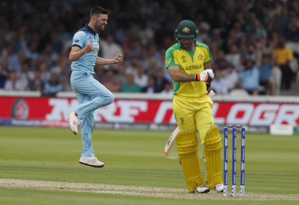 CORRECTS ID   England's Mark Wood celebrates after taking the wicket of Australia's Glenn Maxwell caught behind during their Cricket World Cup match b...