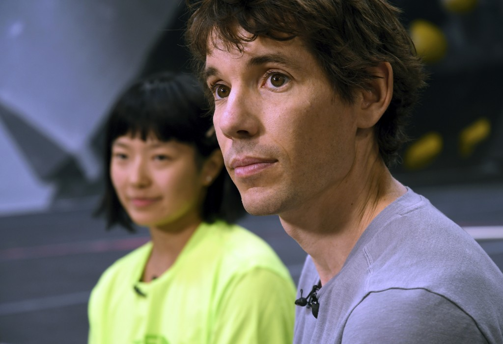 In this June 18, 2019, photo, rock climbers Alex Honnold, right, and Ashima Shiraishi are interviewed at the Earth Treks gym in Englewood, Colo. Honno...