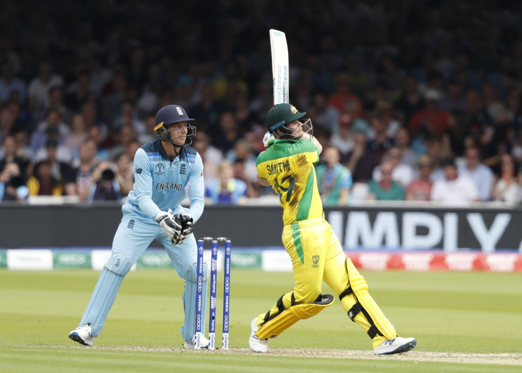 Australia's Steve Smith hits runs off the bowling of England's Adil Rashid during their Cricket World Cup match between England and Australia at Lord'...