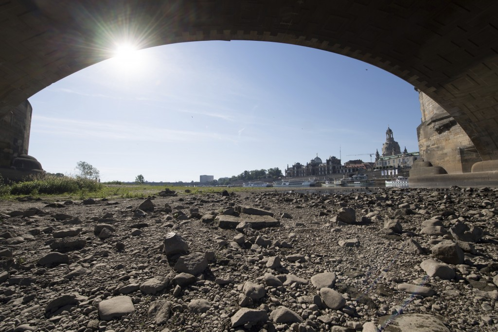 The banks of the river Elbe in Dresden, Germany, are seen running dry on a hot Tuesday, June 25, 2019. Germany expects the hottest day of the year so ...