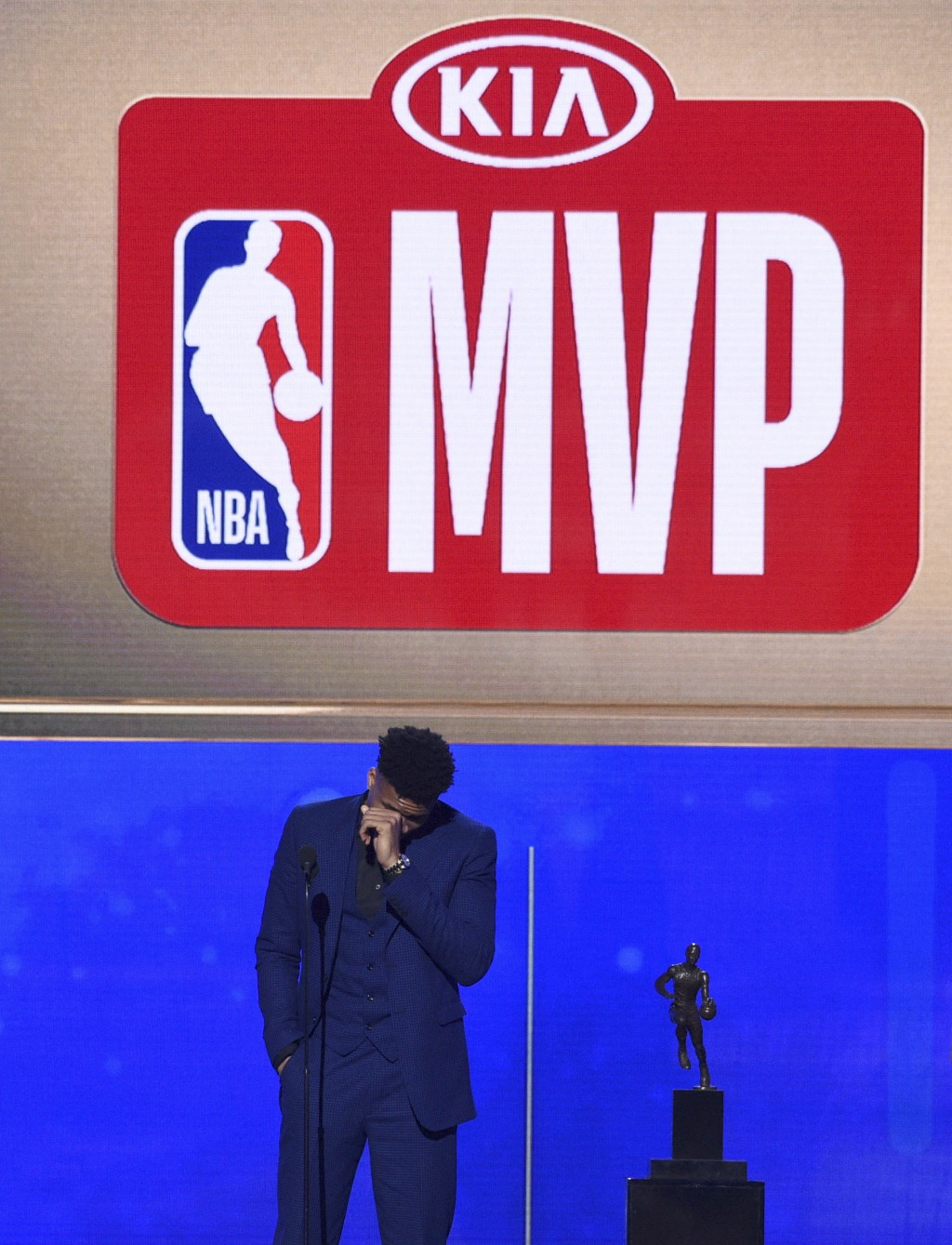 NBA player Giannis Antetokounmpo, of the Milwaukee Bucks, reacts as he accepts the most valuable player award at the NBA Awards on Monday, June 24, 20...