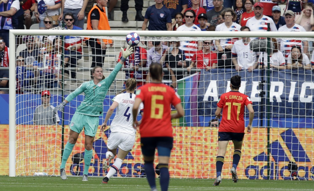 United States goalkeeper Alyssa Naeher, left, fails to stop a goal shot by Spain's Jennifer Hermosoduring the Women's World Cup round of 16 soccer mat...