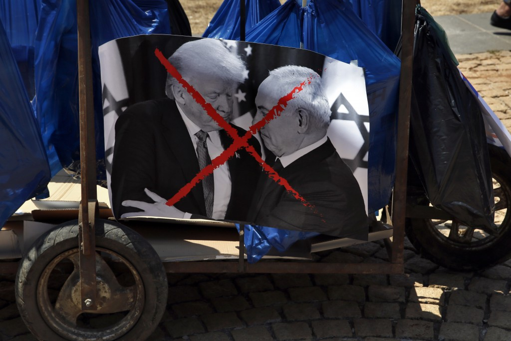 A trash trolly decorated with a photo of U.S. President Donald Trump and Israeli Prime Minister Benjamin Netanyahu during a demonstration organized by...