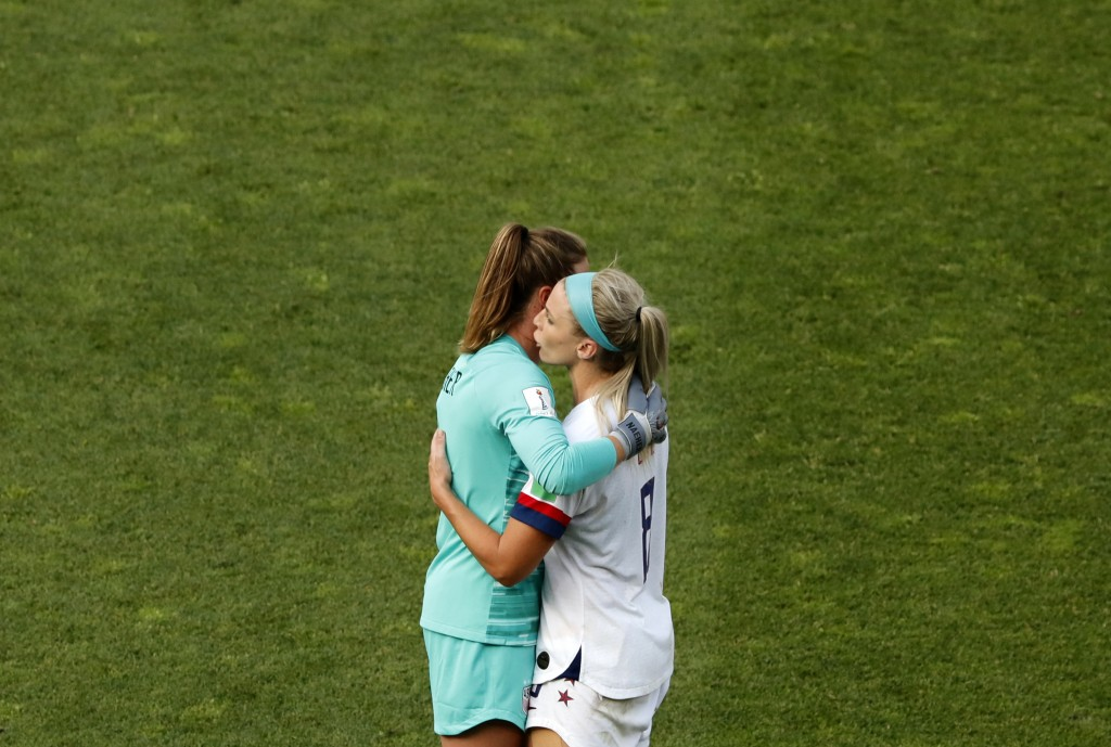 United States goalkeeper Alyssa Naeher, left, and Julie Ertz celebrate at the end of the Women's World Cup round of 16 soccer match between Spain and ...