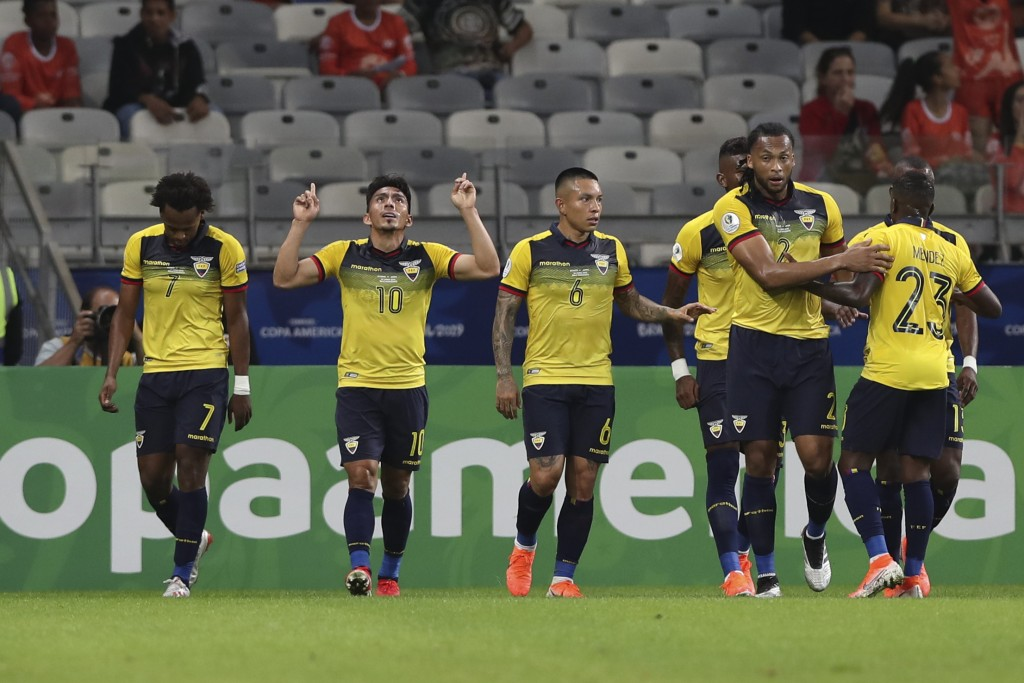 Ecuador's Angel Mena, second left, celebrates after scoring his side's first goal against Japan during a Copa America Group C soccer match at the Mine...