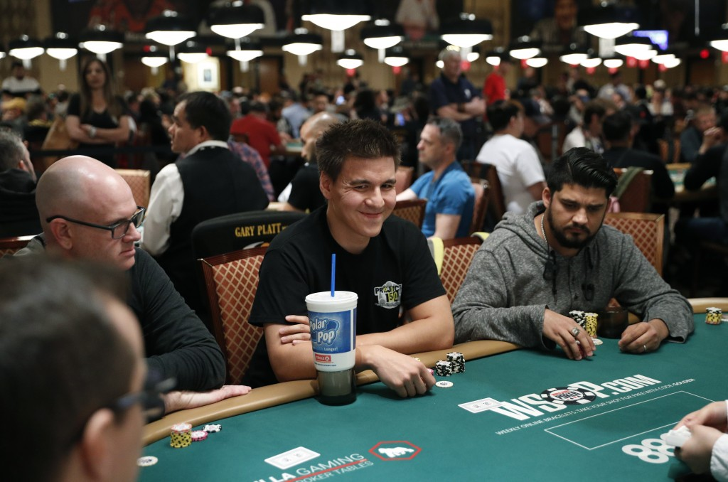 """""""Jeopardy!"""" champion and professional sports gambler James Holzhauer, center, plays in a tournament at the World Series of Poker, Monday, June 24, 201..."""