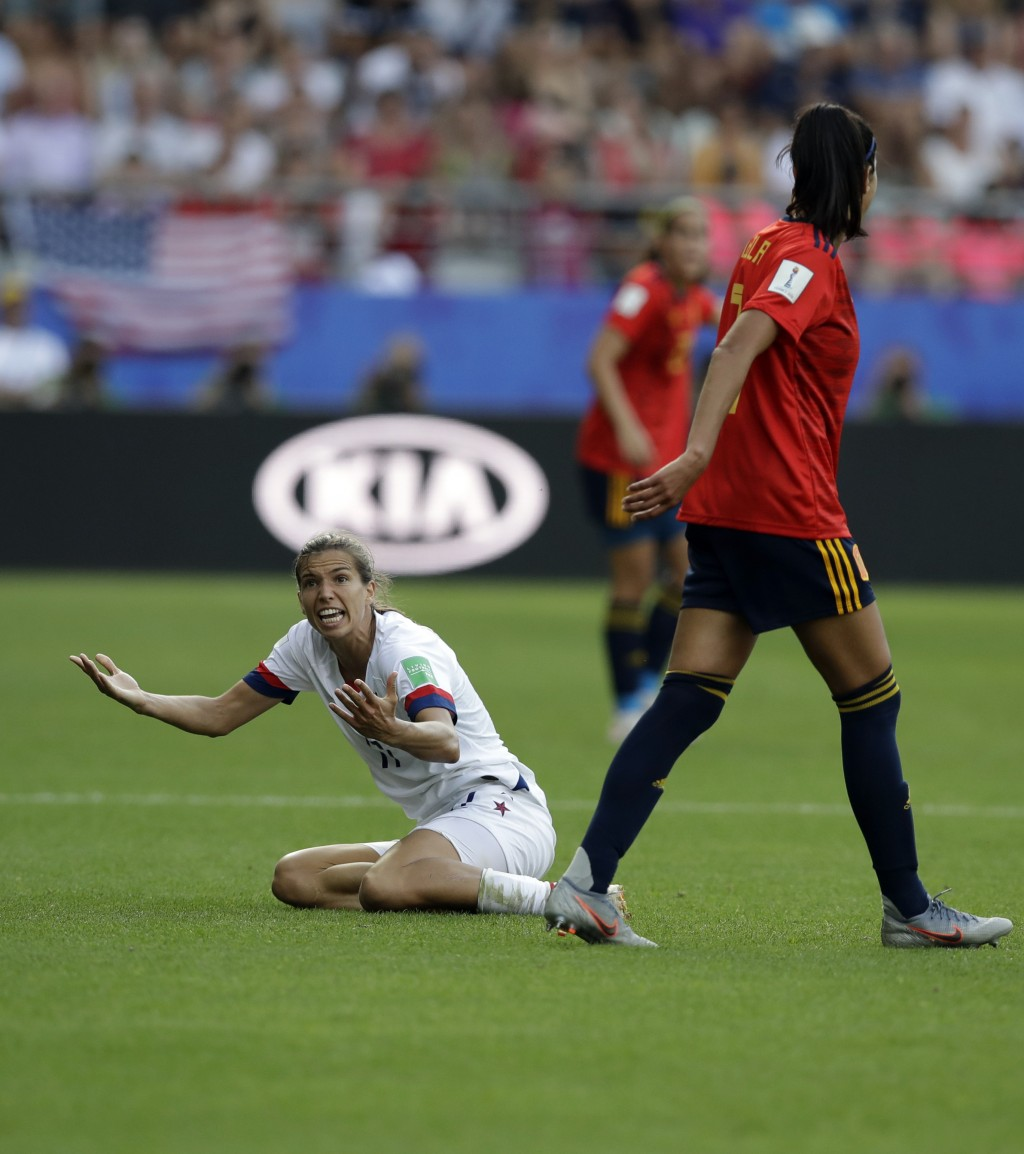 United States'Tobin Heath, left, reacts after a foul by Spain's Leila Ouahabi during the Women's World Cup round of 16 soccer match between Spain and ...