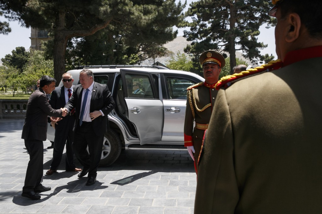 Secretary of State Mike Pompeo, center, is greeted as he arrives at the Presidential Palace in Kabul, Afghanistan, Tuesday, June 25, 2019, during an u...