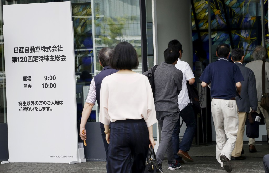 Shareholders enter a conference hall to attend Nissan's general meeting of shareholders in Yokohama, near Tokyo, Tuesday, June 25, 2019. Japanese auto...