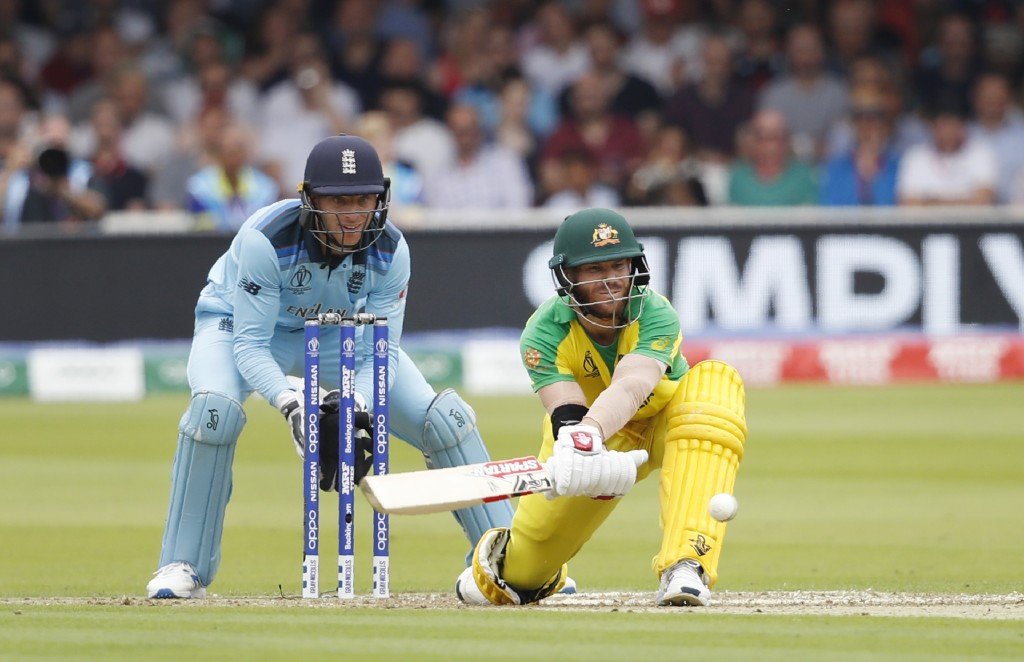 Australia's David Warner plays a shot off the bowling of England's Adil Rashid during their Cricket World Cup match between England and Australia at L...
