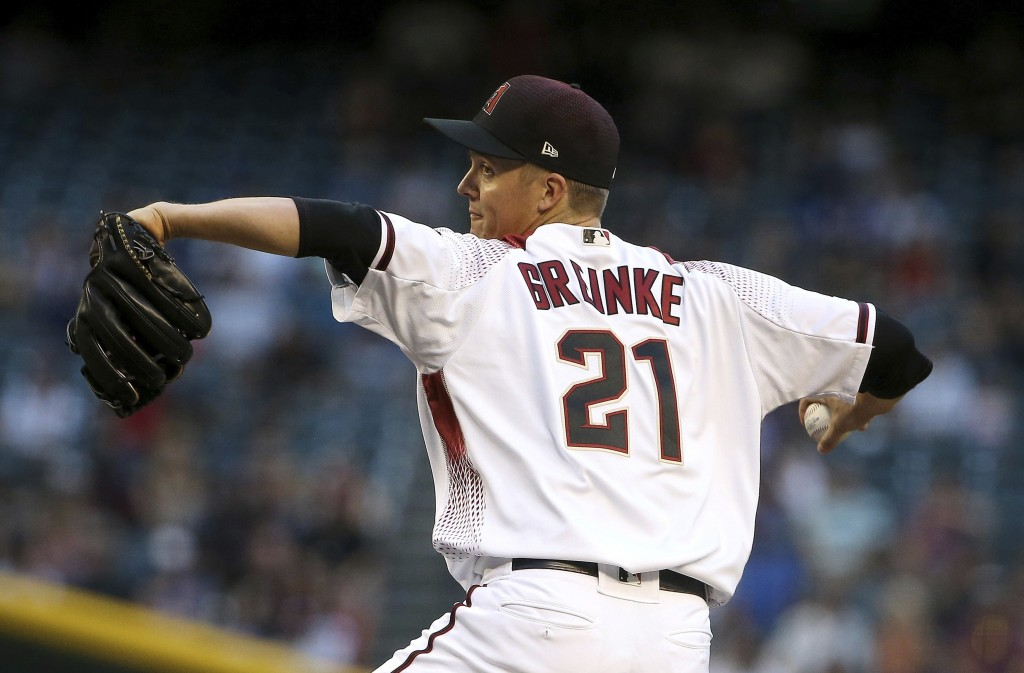 Arizona Diamondbacks starting pitcher Zack Greinke throws against the Los Angeles Dodgers during the first inning of a baseball game Monday, June 24, ...