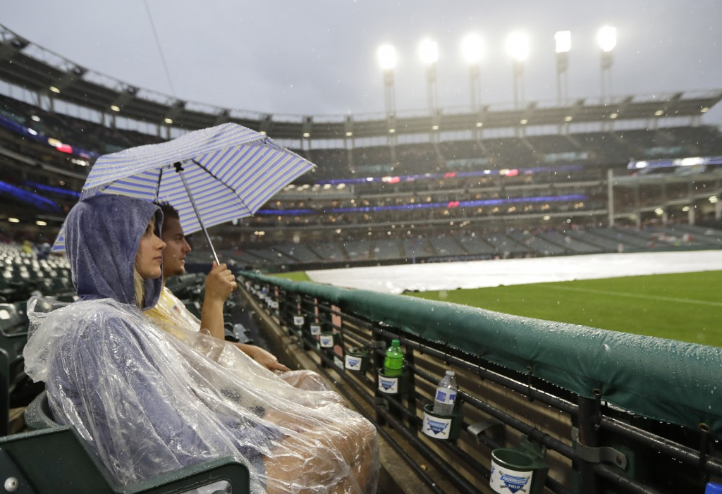 Kristin and Caleb Loosli wait out a rain delay during a baseball game between the Kansas City Royals and the Cleveland Indians, Monday, June 24, 2019,...