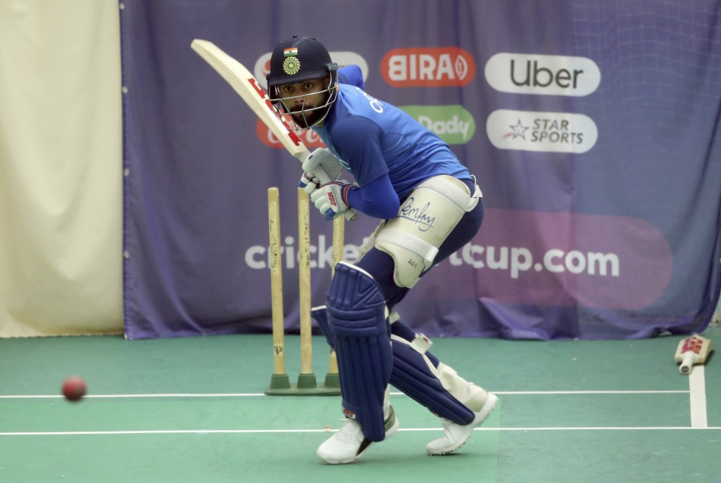 India's captain Virat Kohli bats in the nets during an indoor training session ahead of their Cricket World Cup match against West Indies at Old Traff...