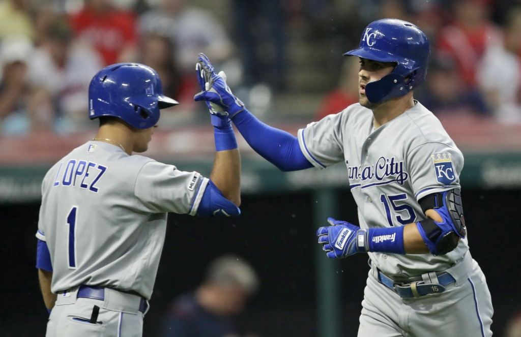Kansas City Royals' Nicky Lopez, left, congratulates Whit Merrifield after Merrifield hit a solo home in the fourth inning in a baseball game against ...
