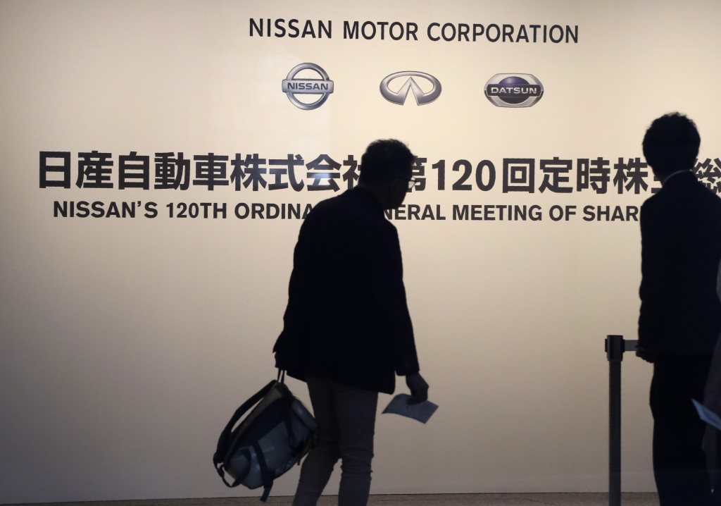 Shareholders arrive at a conference hall to attend Nissan's general meeting of shareholders in Yokohama, near Tokyo, Tuesday, June 25, 2019. Japanese ...