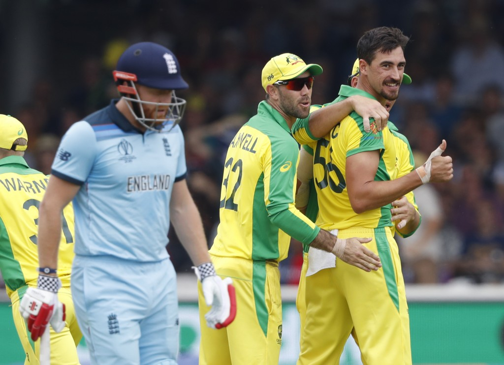 Australia's Mitchell Starc turns and give a thumbs up towards the dressing room after taking the wicket of England's captain Eoin Morgan during their ...