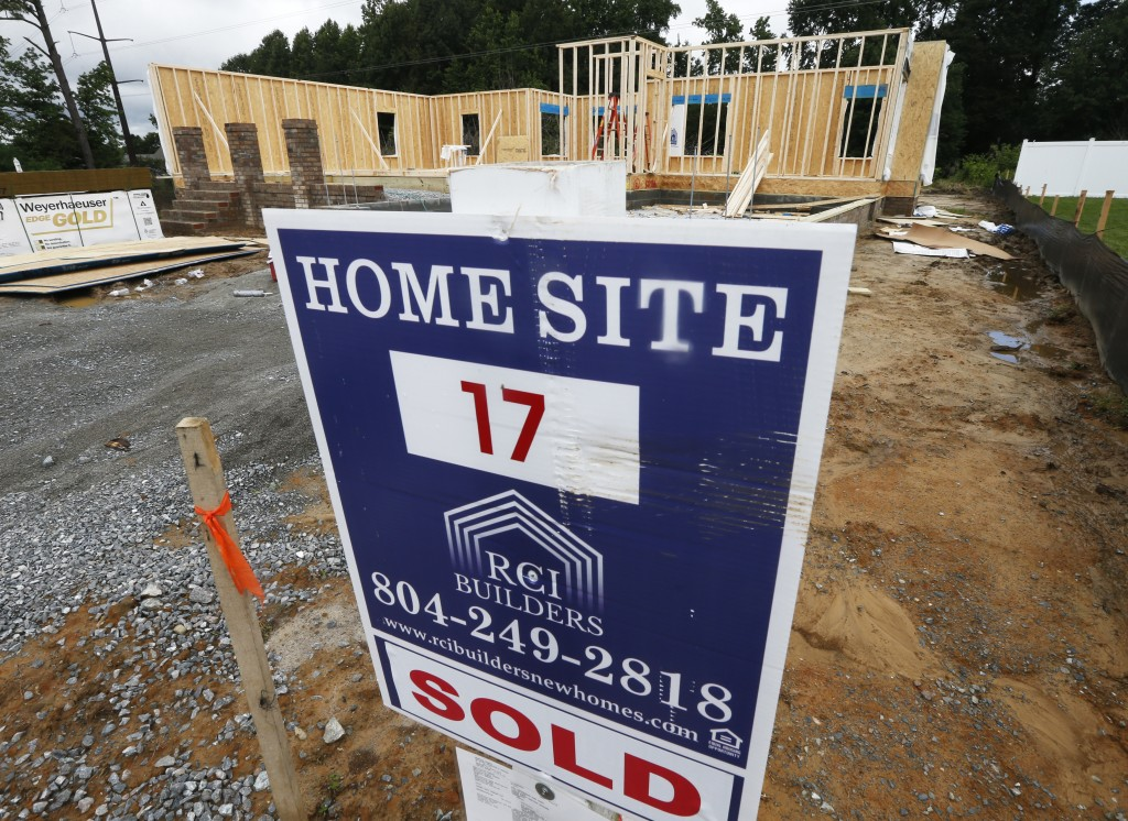 In this June 13, 2019, photo a new home is under construction in Mechanicsville, Va. On Tuesday, June 25, The Commerce Department reports on sales of ...