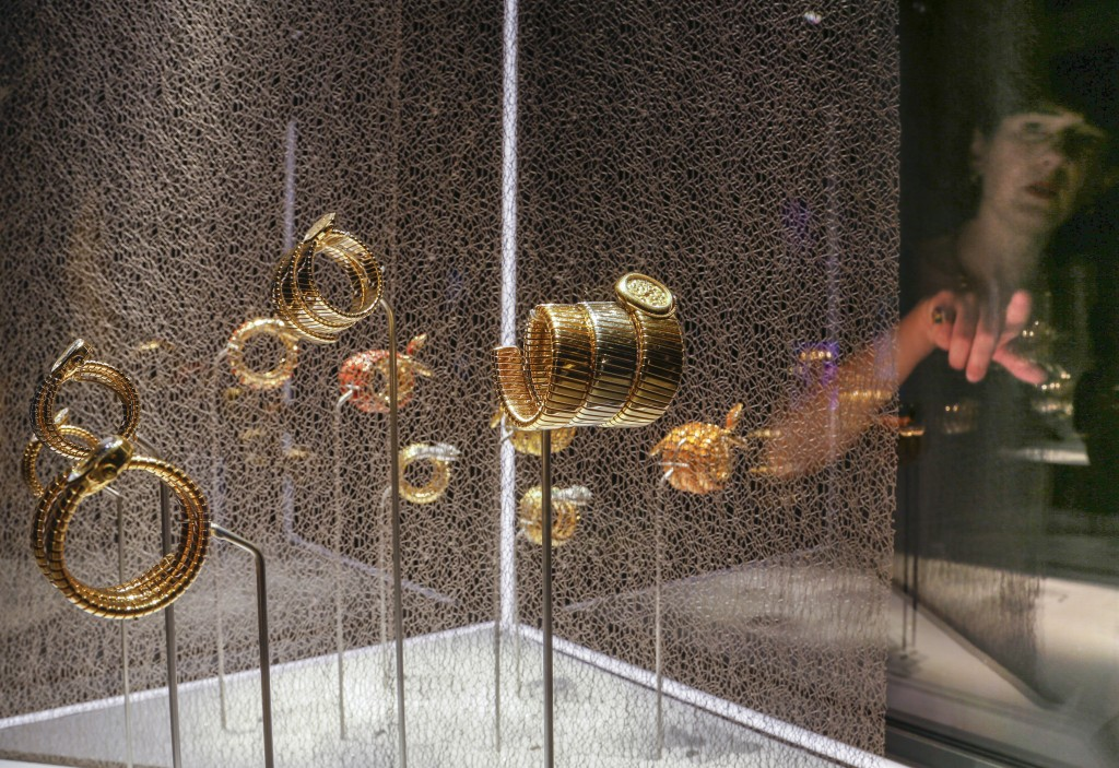 """A woman looks at bracelets on display during a preview of the exhibition """"Bulgari. The story, the dream"""" at St. Angel Castle in Rome, Tuesday, June 25..."""