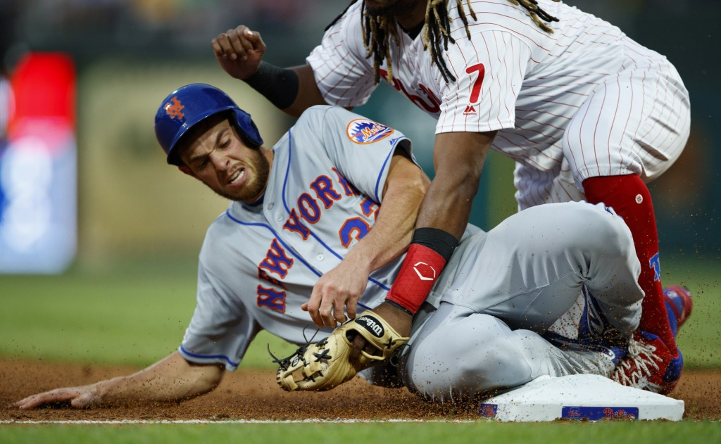 New York Mets' Steven Matz, left, is tagged out by Philadelphia Phillies third baseman Maikel Franco after trying to advance to third on a single by J...