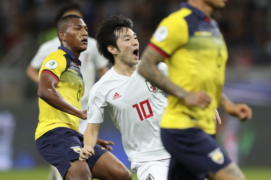 Japan's Shoya Nakajima, center, celebrates after scoring his side's first goal against Ecuador during a Copa America Group C soccer match at the Minei...