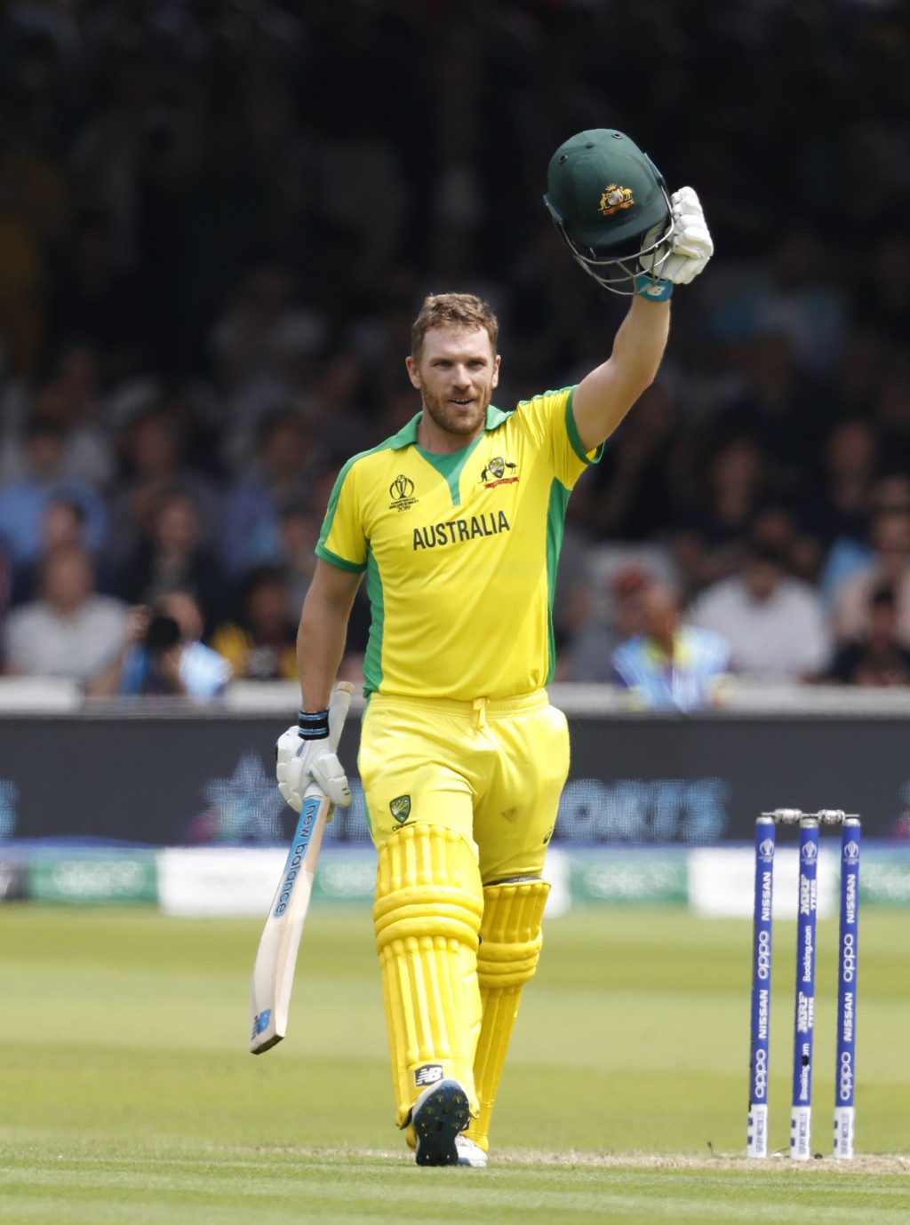 Australia's captain Aaron Finch celebrates getting 100 runs not out during their Cricket World Cup match between England and Australia at Lord's crick...