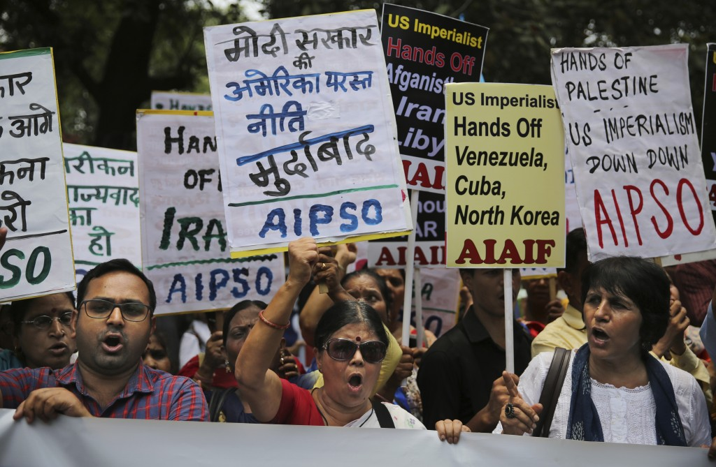 Activists of various left-wing organizations denounce American policies in the Middle East while protesting against the upcoming visit of U.S. Secreta...