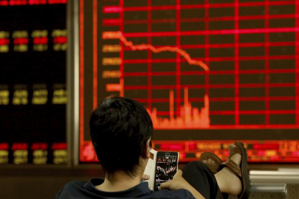 A man monitors stock prices at a brokerage in Beijing on Tuesday, June 25, 2019. Major Asian stock markets declined Tuesday as traders looked ahead to...