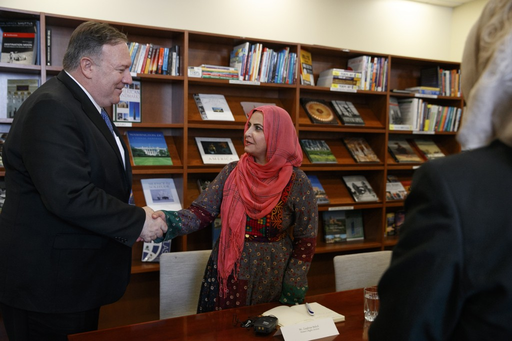 Secretary of State Mike Pompeo, left, shakes hands with Zarghona Baloch, a women's rights activist, as he meets with representatives from Afghan civil...