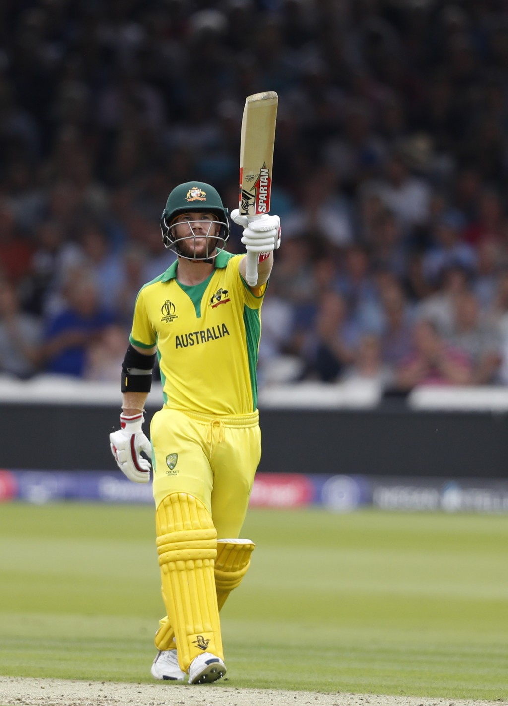 Australia's David Warner celebrates after getting 50 runs not out during their Cricket World Cup match between England and Australia at Lord's cricket...